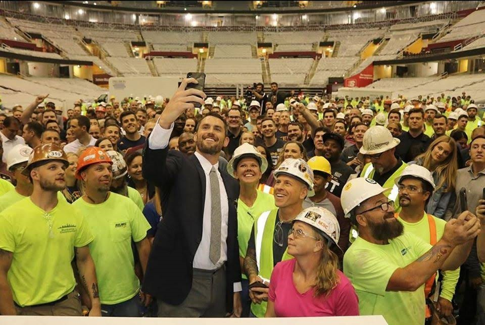Kevin Love with Cleveland Cavaliers arena staff