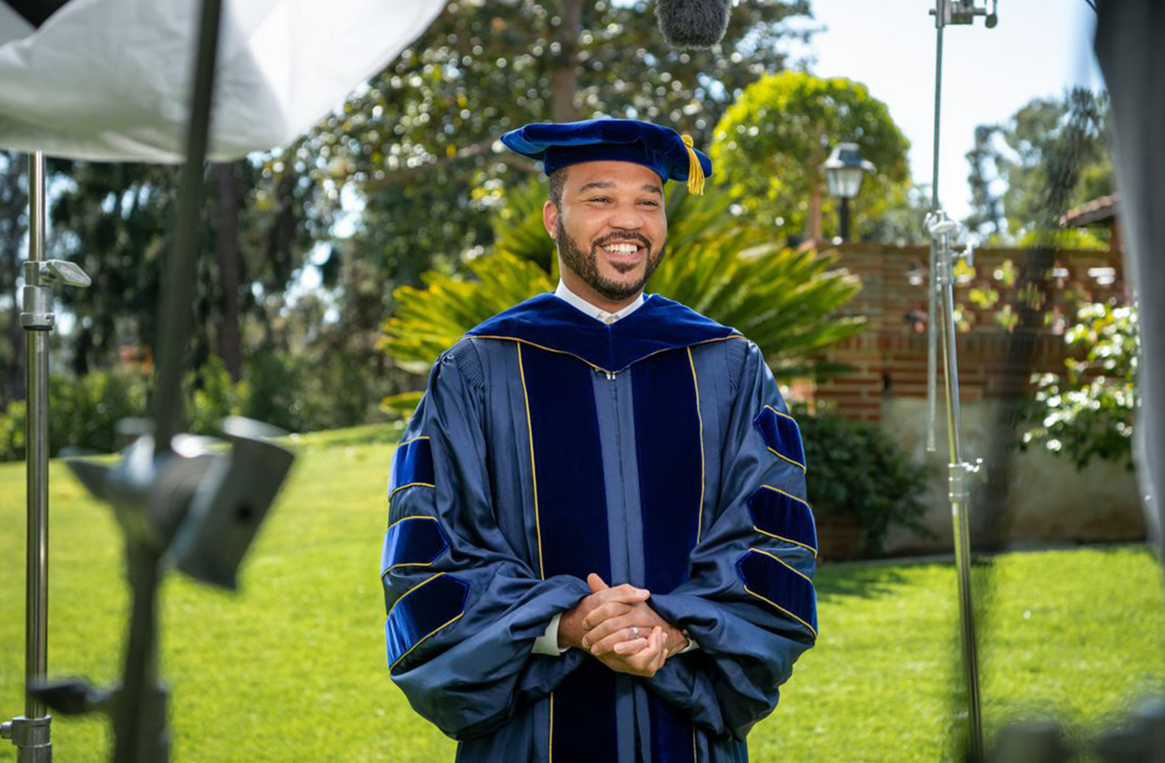 """UCLA Alumni President D'Artagnan Scorza '07, Ph.D. 13, delivering his commencement speech """"You are the Class of Hope"""""""