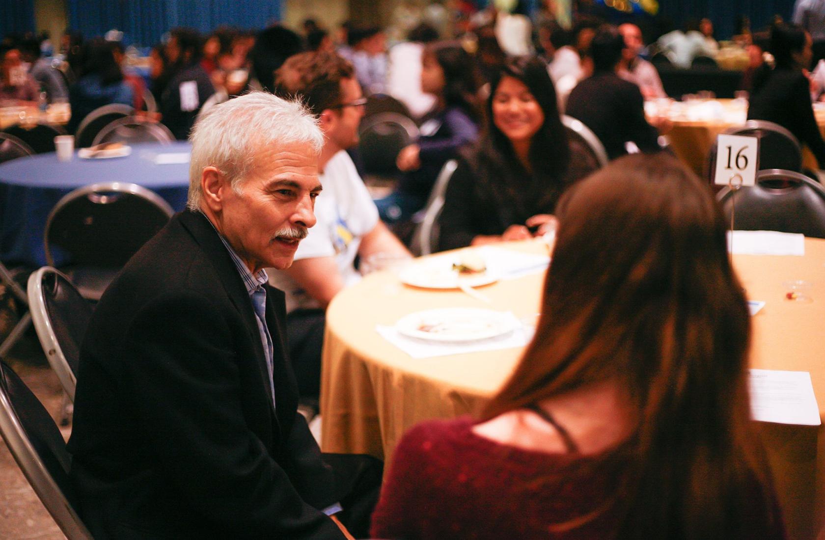 An alumni mentor talking at an event